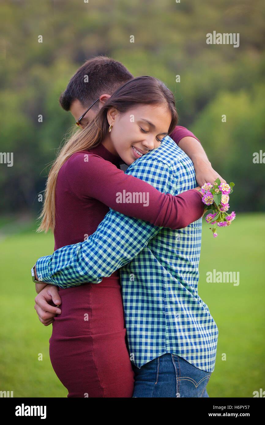 Loving happy romantic couple cuddling stock photo 124664771 alamy loving happy romantic couple cuddling altavistaventures Images