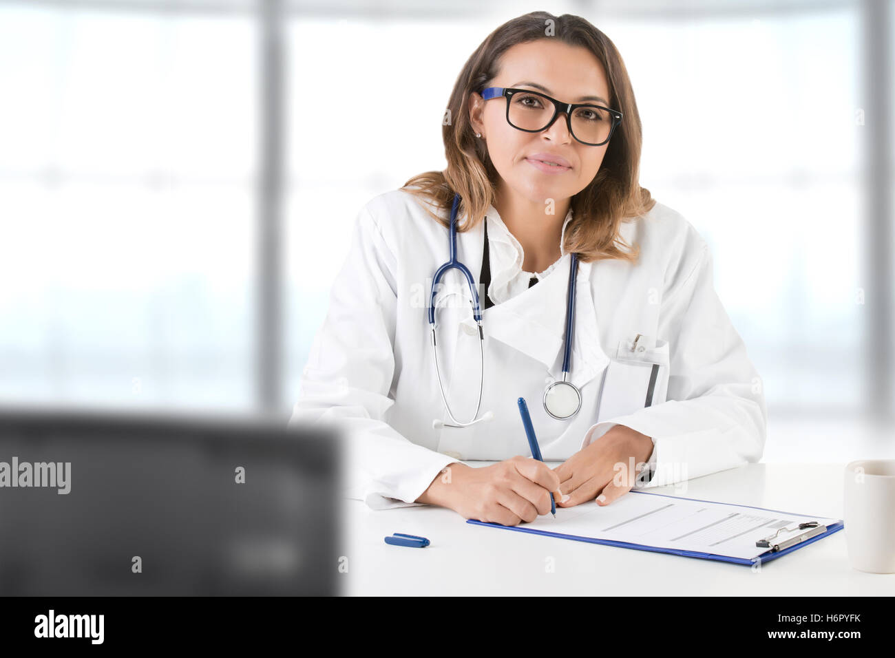 Female doctor at work, isolated in white - Stock Image