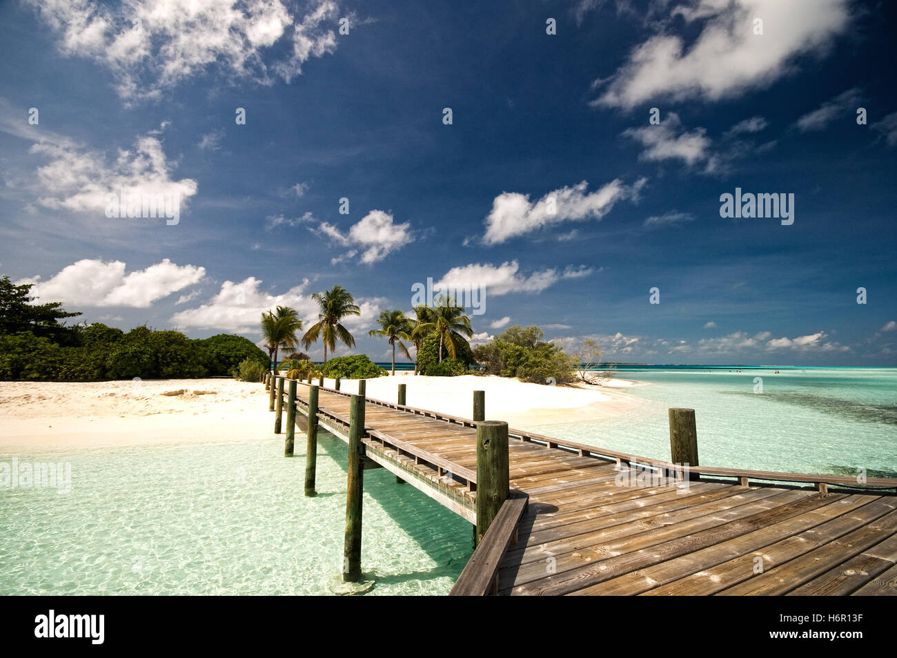 wooden bridge to desert island - Stock Image