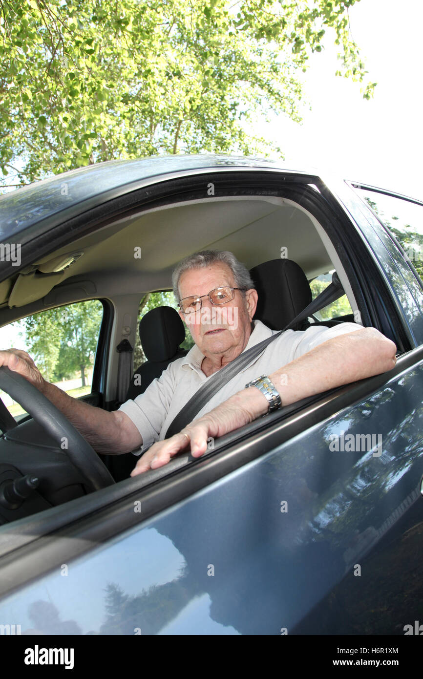 car automobile vehicle means of travel motor vehicle mobility driver old man driving control retired aging car insurance - Stock Image