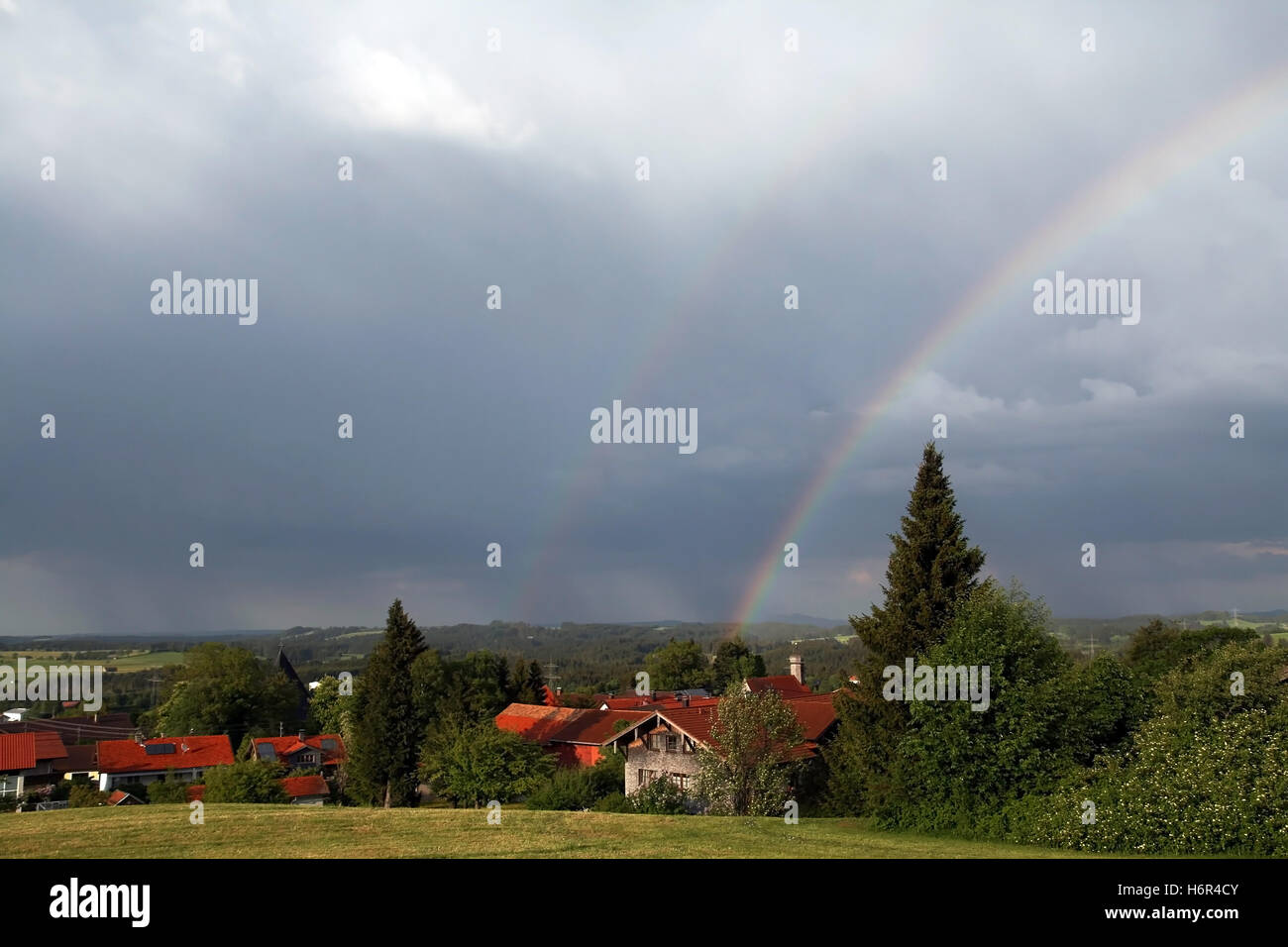 the rainbow over the church - Stock Image