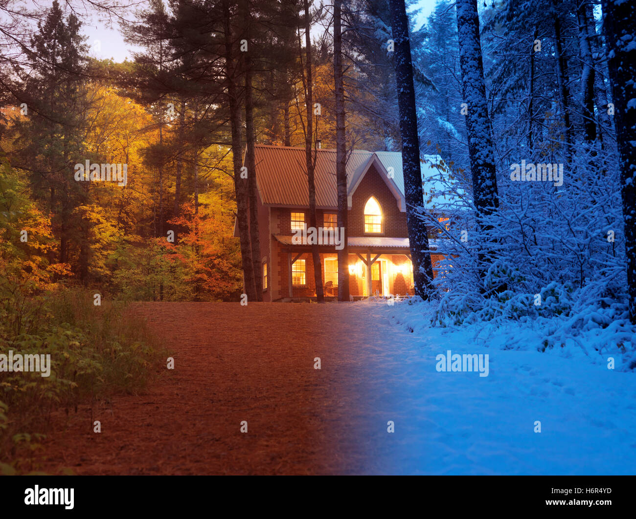 Artistic concept of a country house between colorful fall and snowy winter seasons in a beautiful nature scenery - Stock Image