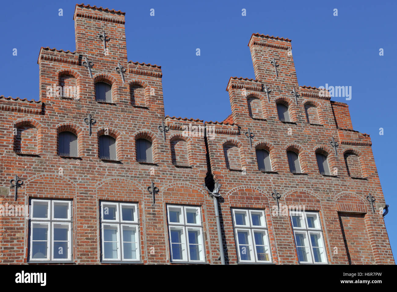 old town sightseeing style of construction architecture architectural style gable corbie-gable luebeck house home - Stock Image