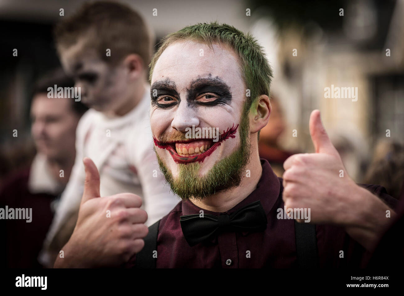 Zombies. Families and children gather for the annual Zombie Crawl in Newquay, Cornwall. - Stock Image