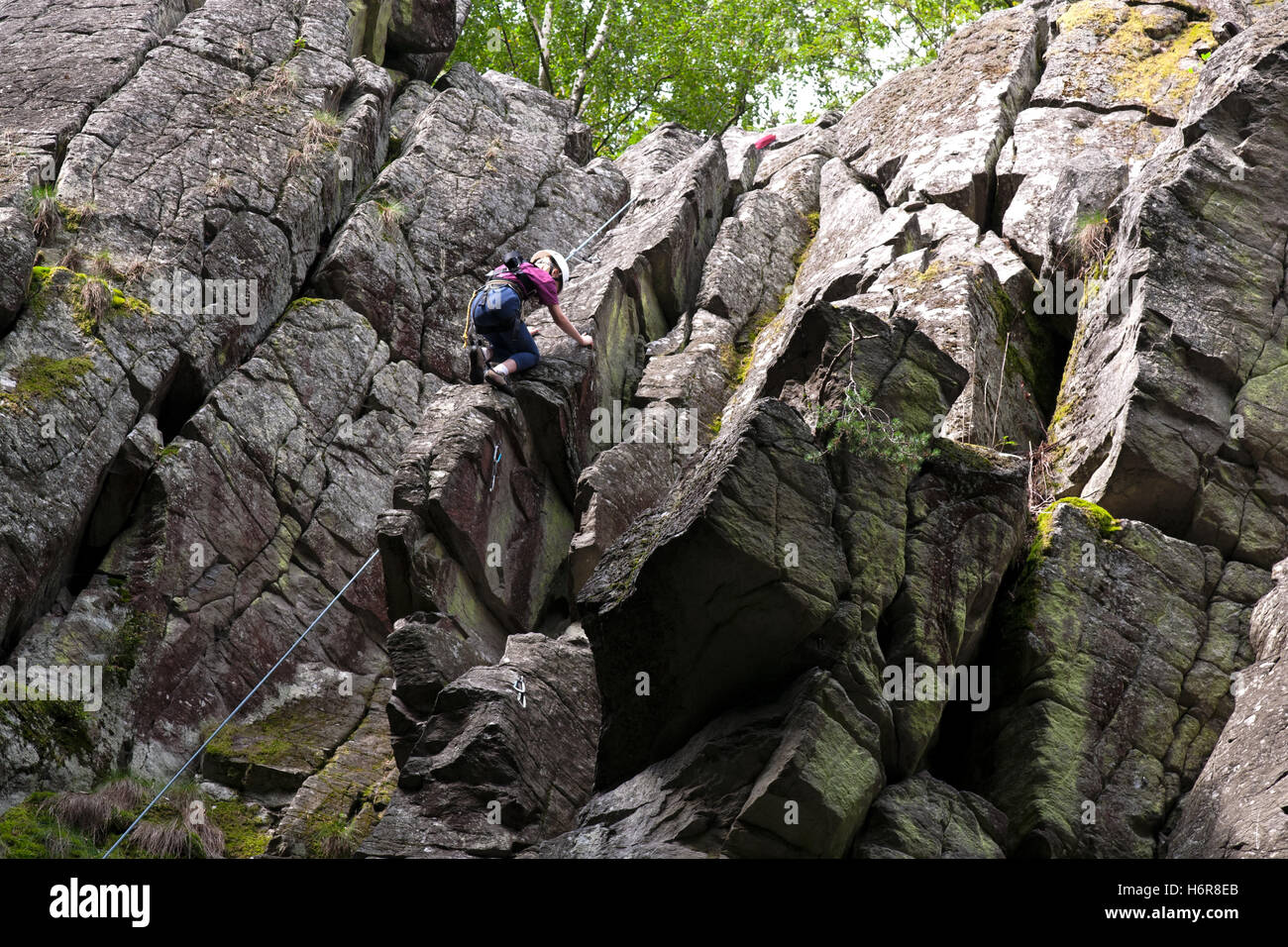 climbing on the stone wall,rhoen,hesse,germany - Stock Image