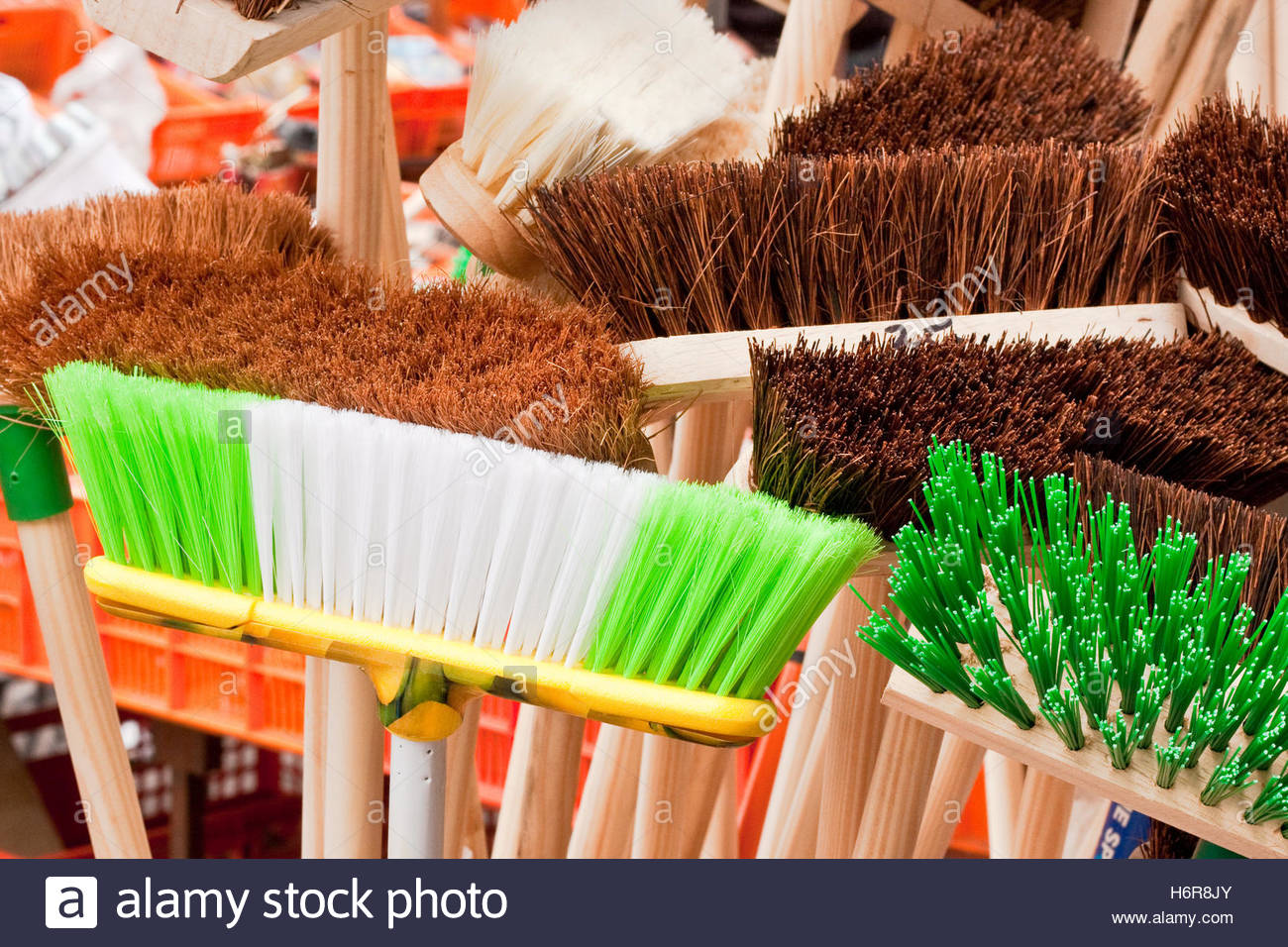 blue house building tool isolated green soft spring bouncing bounces hop skipping frisks jumping jump brush bristles - Stock Image