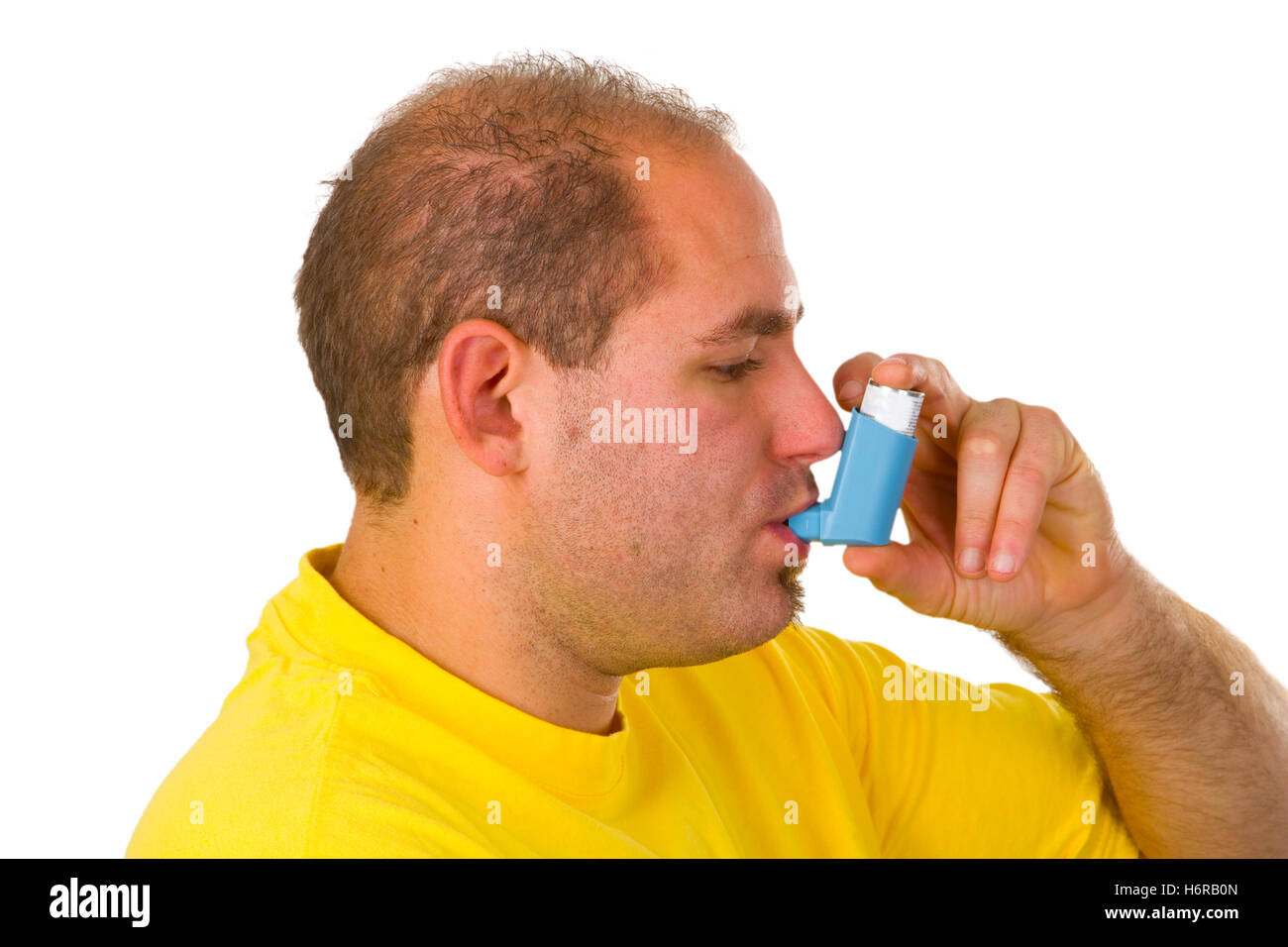 young man with metered dose inhaler - Stock Image