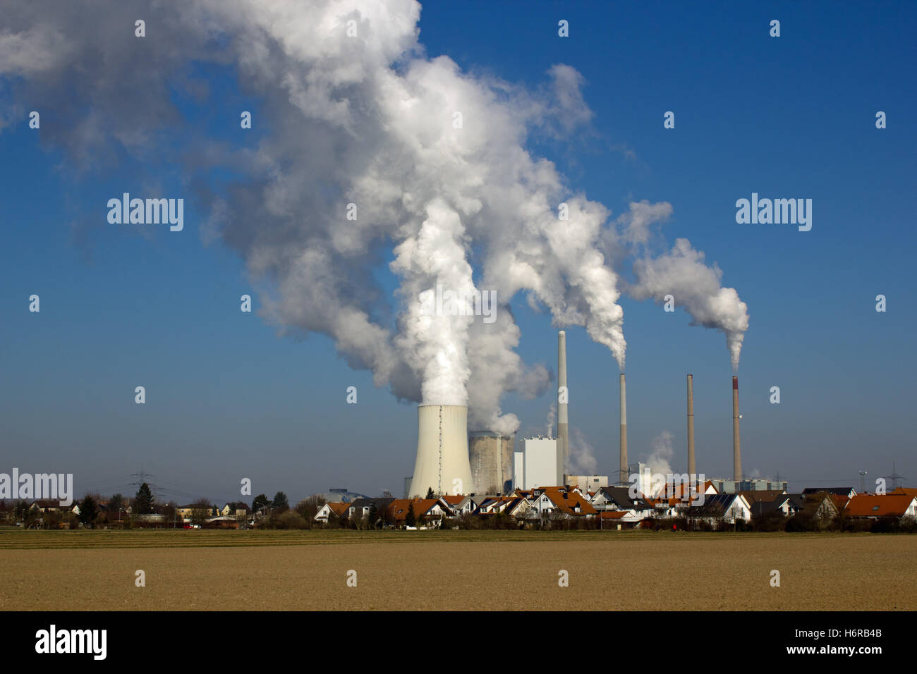 nuclear power plant and residential area Stock Photo