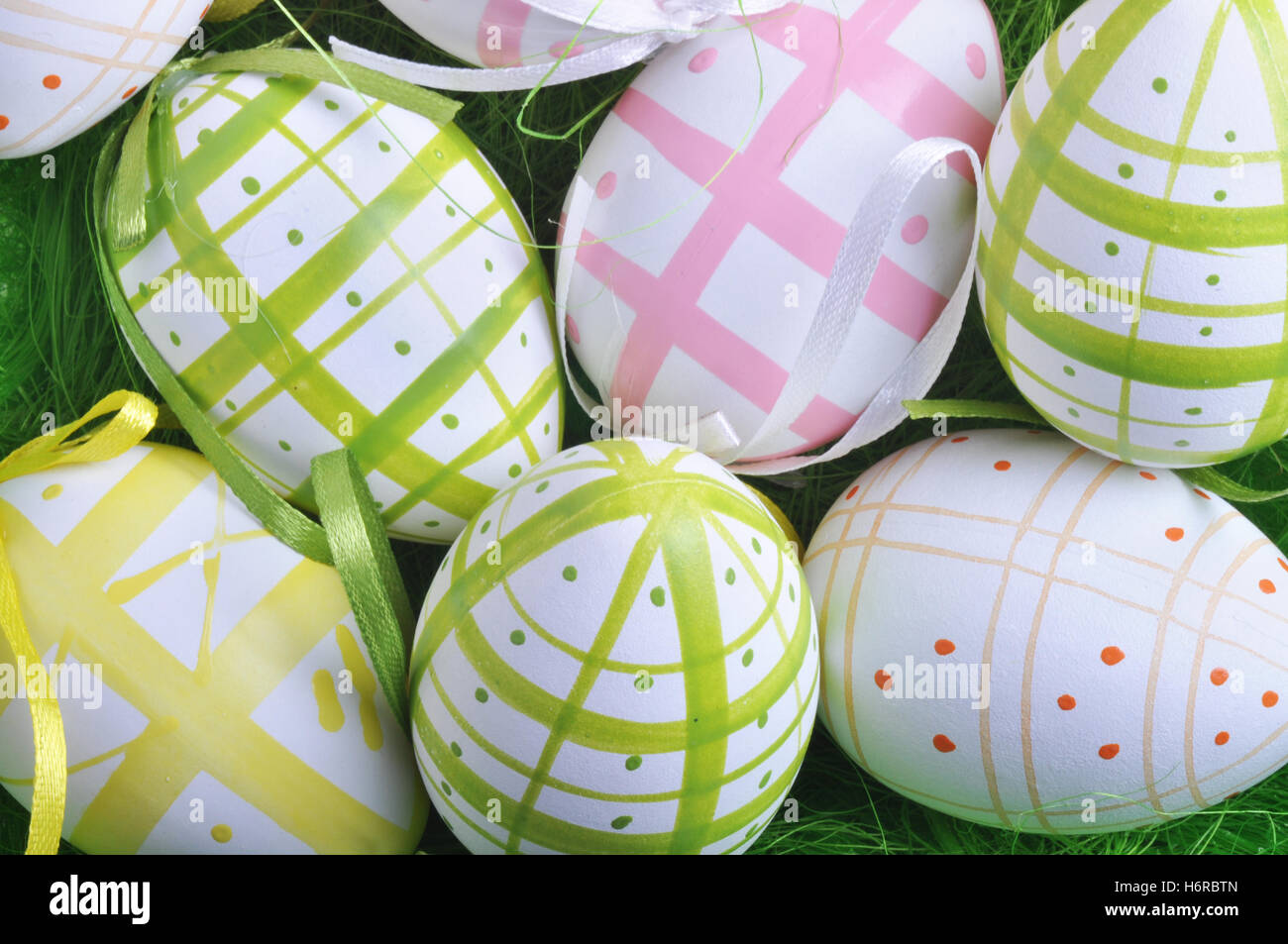 colour easter spring bouncing bounces hop skipping frisks jumping jump paint egg painted eggs meadow grass lawn - Stock Image