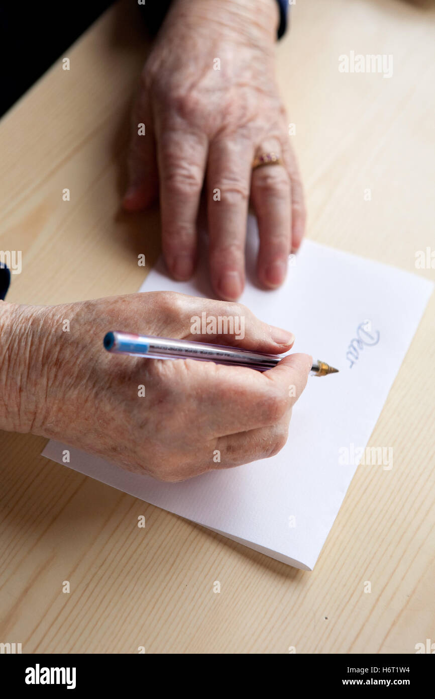 woman note memo hand hands write wrote writing writes greeting female written dear letter old elderly sheet of paper - Stock Image