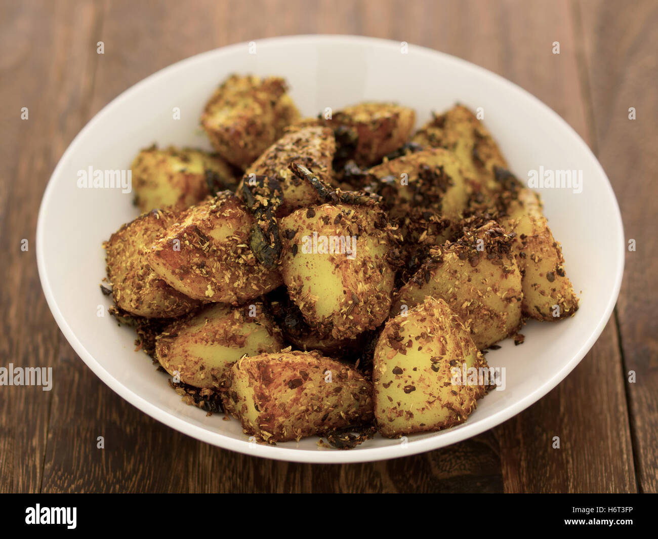 vegetable spices potatoes carbohydrates baked indian roasted parched food aliment spice colour closeup horizontal - Stock Image