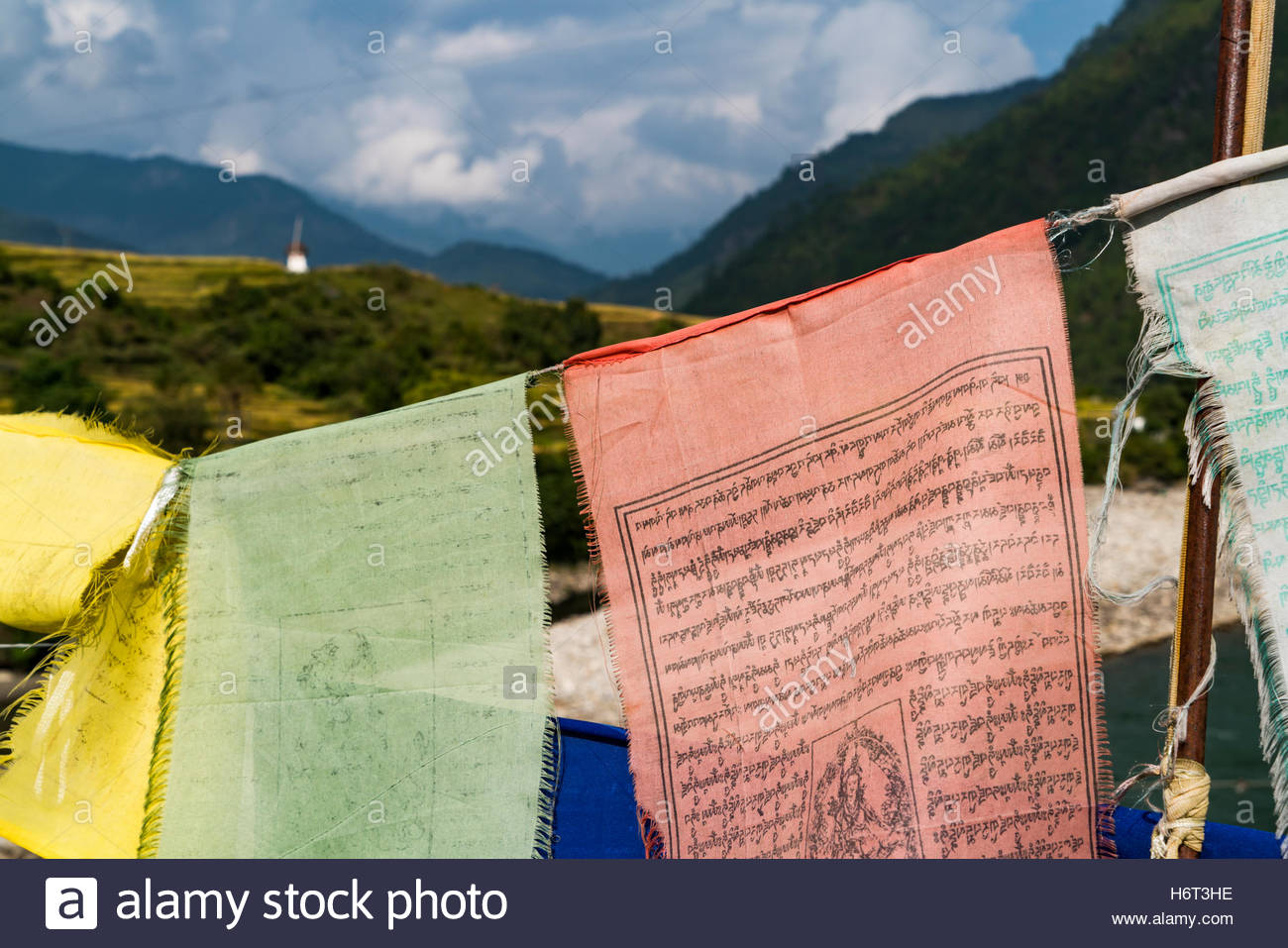 Prayer flags on a bridge over the Mo Chhu river in Punakha, Bhutan. - Stock Image
