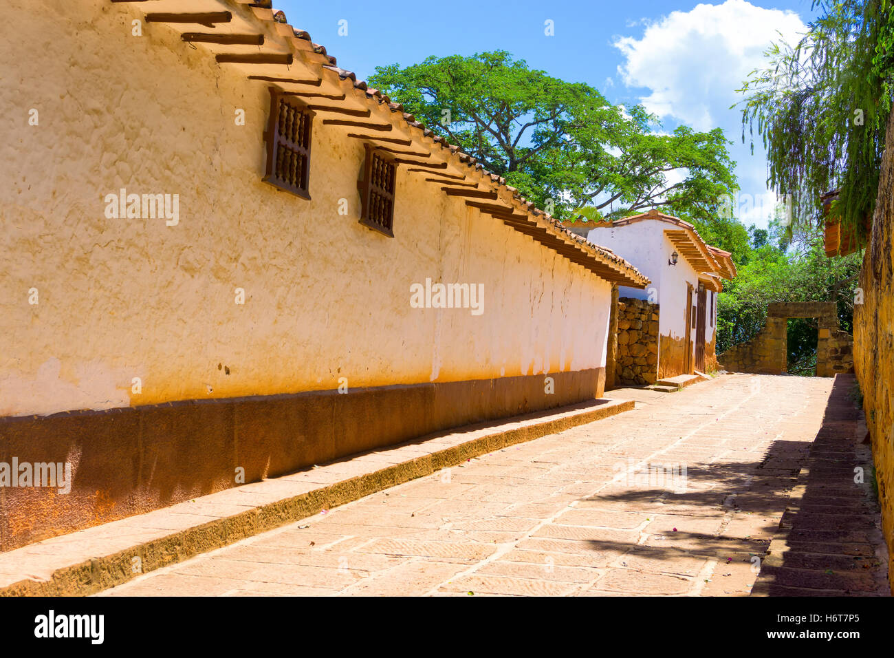 View of a sandstone street in beautiful colonial Barichara, Colombia Stock Photo