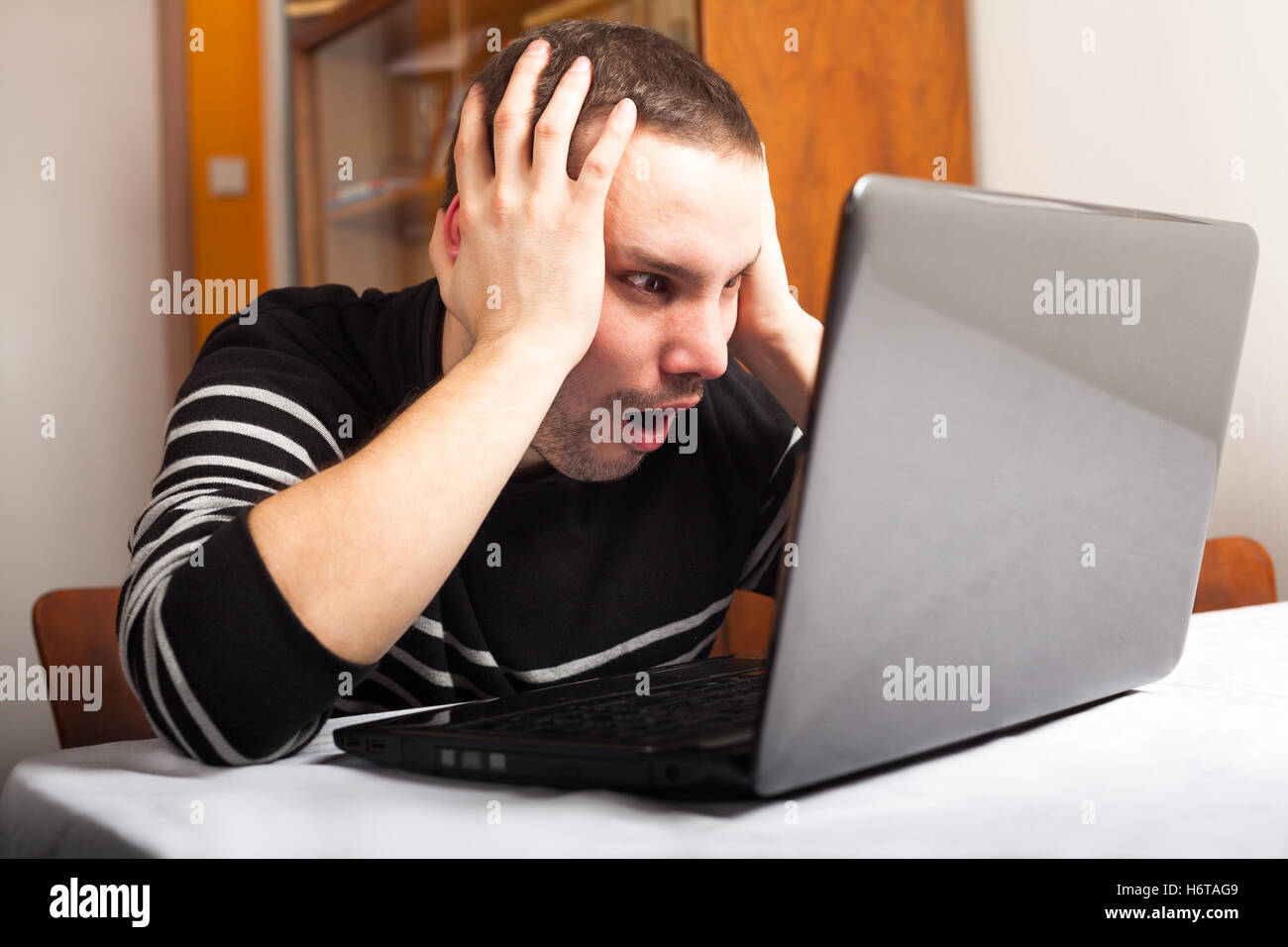 humans human beings people folk persons human human being laptop notebook computers computer men man PC inside lifestyle - Stock Image