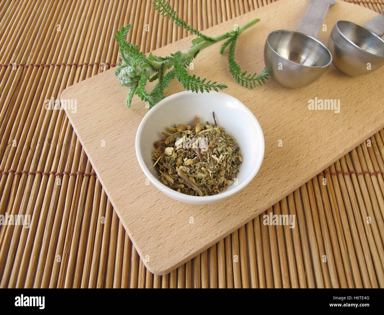 tea yarrow tea leaves blossoms material drug anaesthetic addictive drug drugs compositae dried means agent medicine - Stock Image