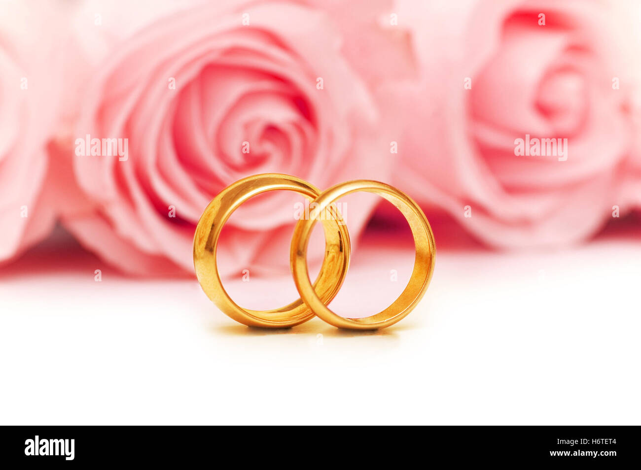 Red Roses Wedding Ring Isolated Stock Photos & Red Roses Wedding ...