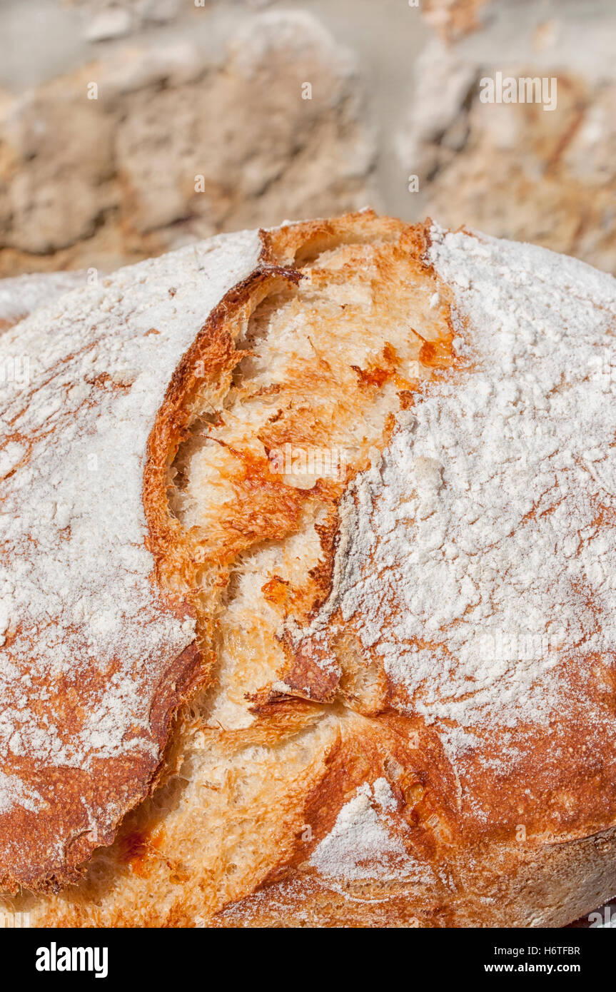 Close up of French crusty bread or Farmhouse Loaf - Stock Image