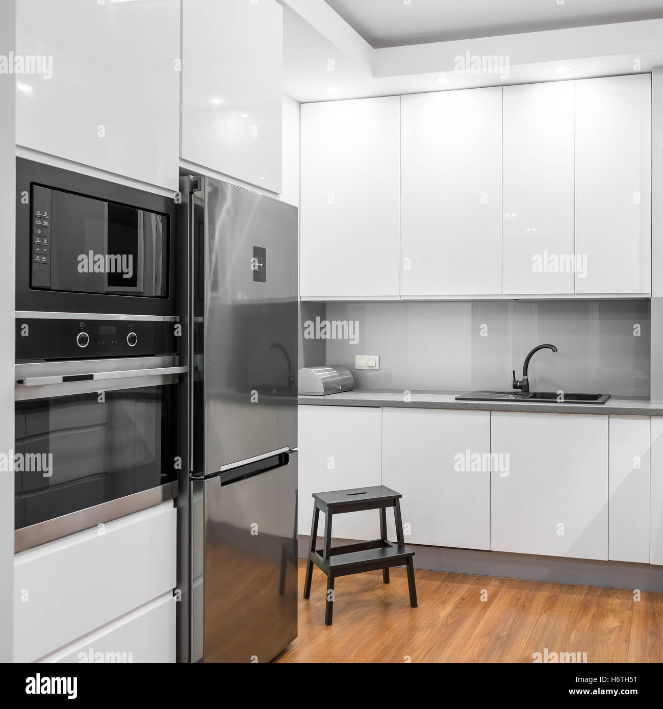 White High-gloss Kitchen With Silver Fridge, Oven And