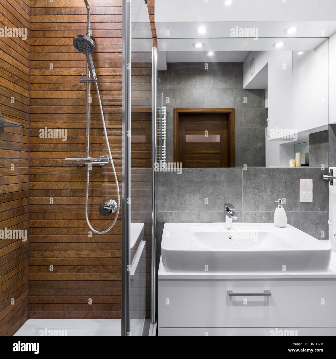 New Style Bathroom With Wood Effect Tiles, Shower, Mirror And Basin