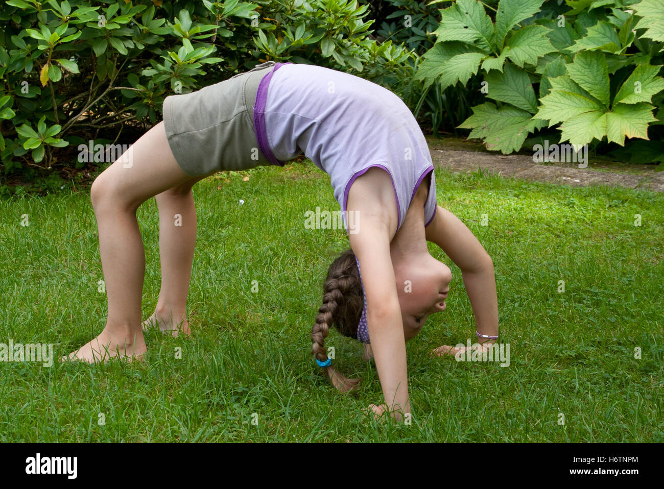 sport sports sporty athletic wiry pithy heavyset tight sporting yoga mobile blond girl girls child children kids - Stock Image