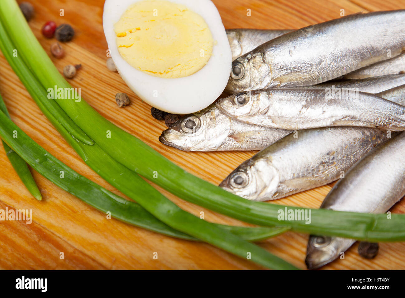 food aliment salt pepper wood shell silver freshness small tiny little short spring bouncing bounces hop skipping - Stock Image