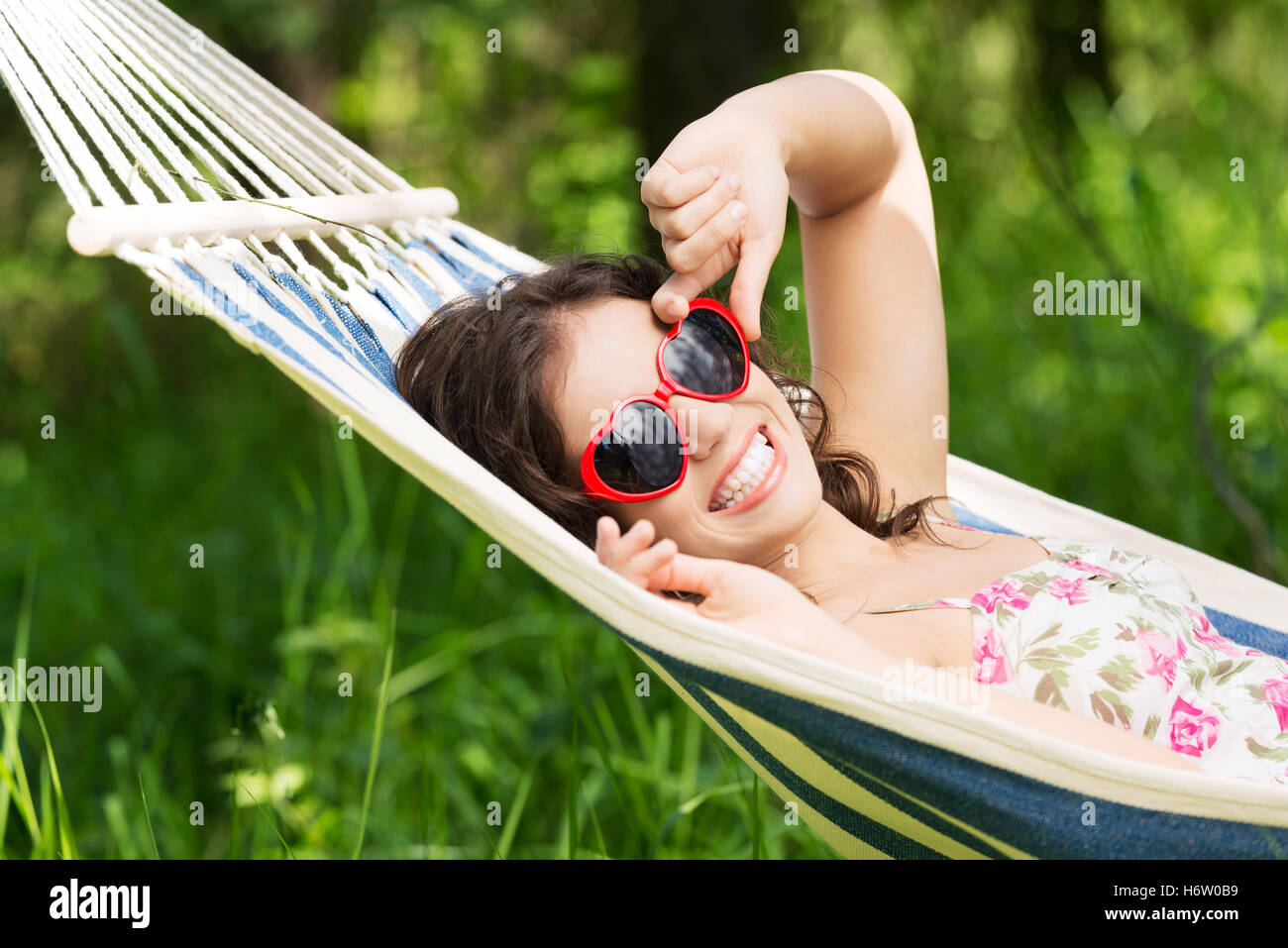 young woman lying in a hammock - Stock Image