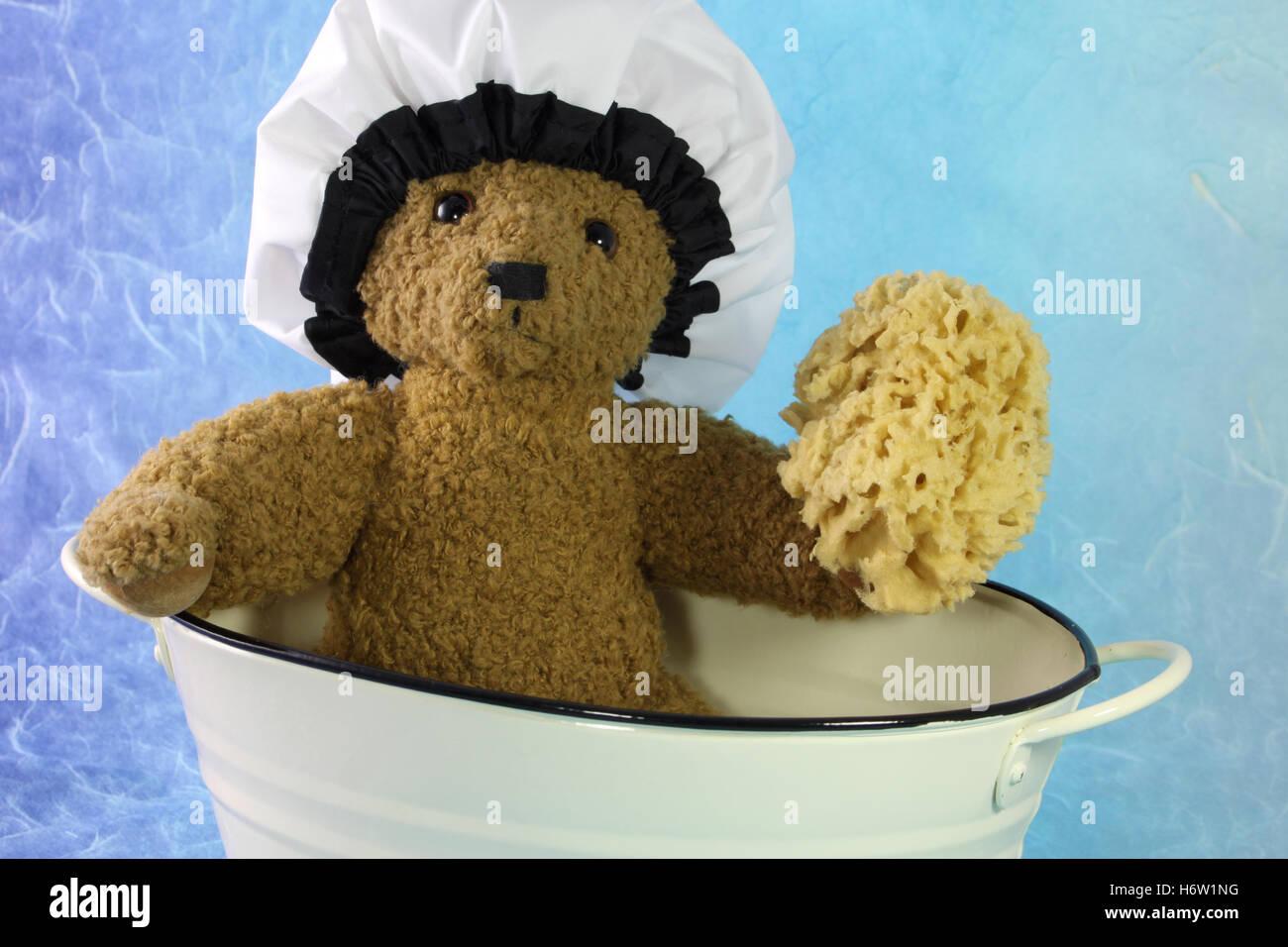 toy teddy teddy bear teddybear bath tub tub bathtub comforter pictogram symbol pictograph trade symbol friend spa Stock Photo
