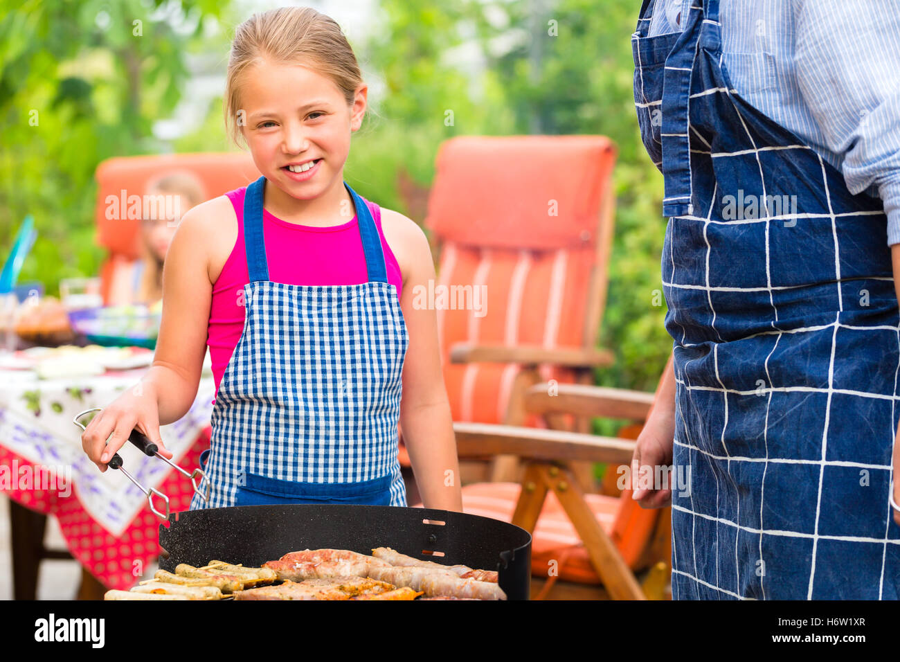 cookout with family in the garden in front of house - Stock Image