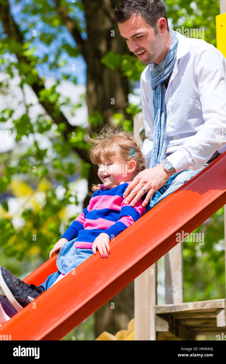rise climb climbing ascend uphill tread clamber chute daddies fathers daughters child familiy family daugther daughter - Stock Image