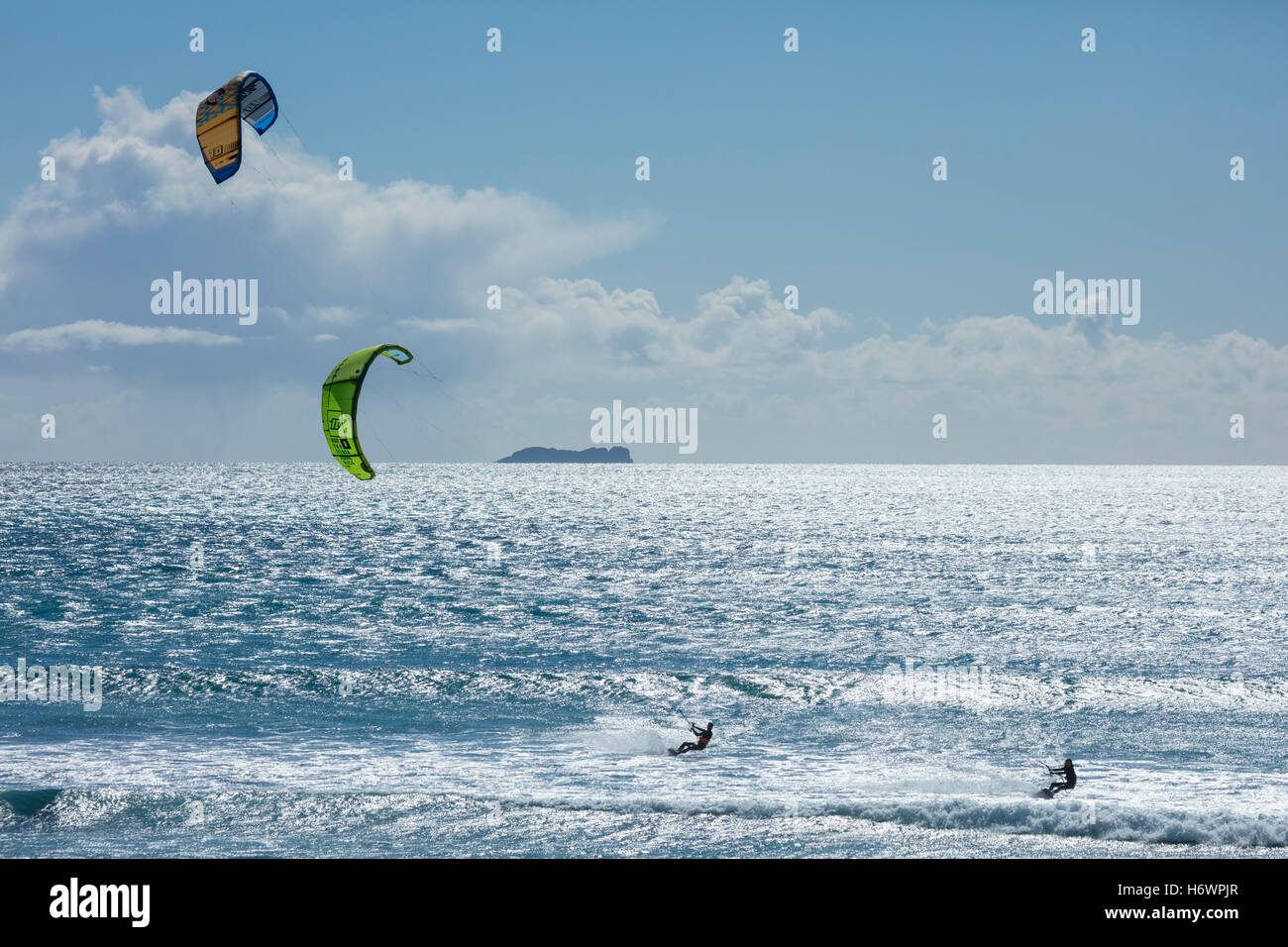 Francois Colussi and Sophie Mathews kitesurfing off Keel beach, Achill Island, County Mayo, Ireland. - Stock Image