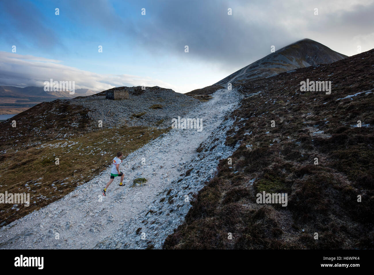 Triathlete Con Doherty running up Croagh Patrick, County Mayo, Ireland. - Stock Image