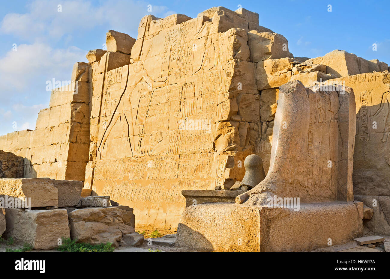 The ancient relief on the Seventh Pylon of Karnak Temple depicts Thutmose III, defiting his enemies, Luxor, Egypt. - Stock Image