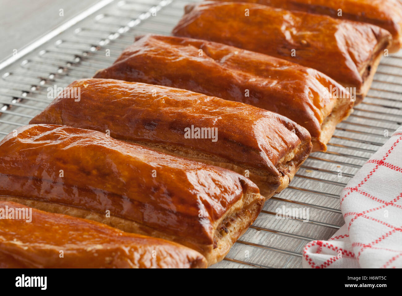 Fresh baked sausage rolls out of the oven - Stock Image