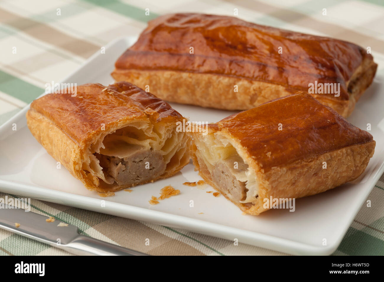 Fresh baked half sausage roll - Stock Image