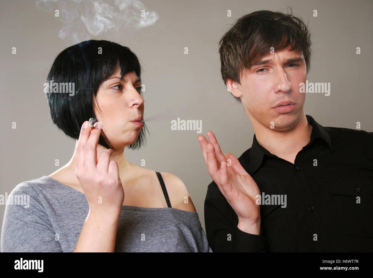 smoking vs. non smoking - Stock Image