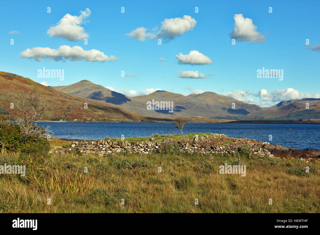 Light fluffy clouds over Loch Scridain on the Isle of Mull with Ben More at the head of the loch on the left - Stock Image