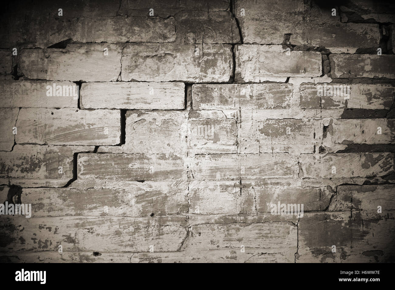 construction work stones old wall craftsman tradesman handicraftsman wall sandstone crannies masonry destruction - Stock Image