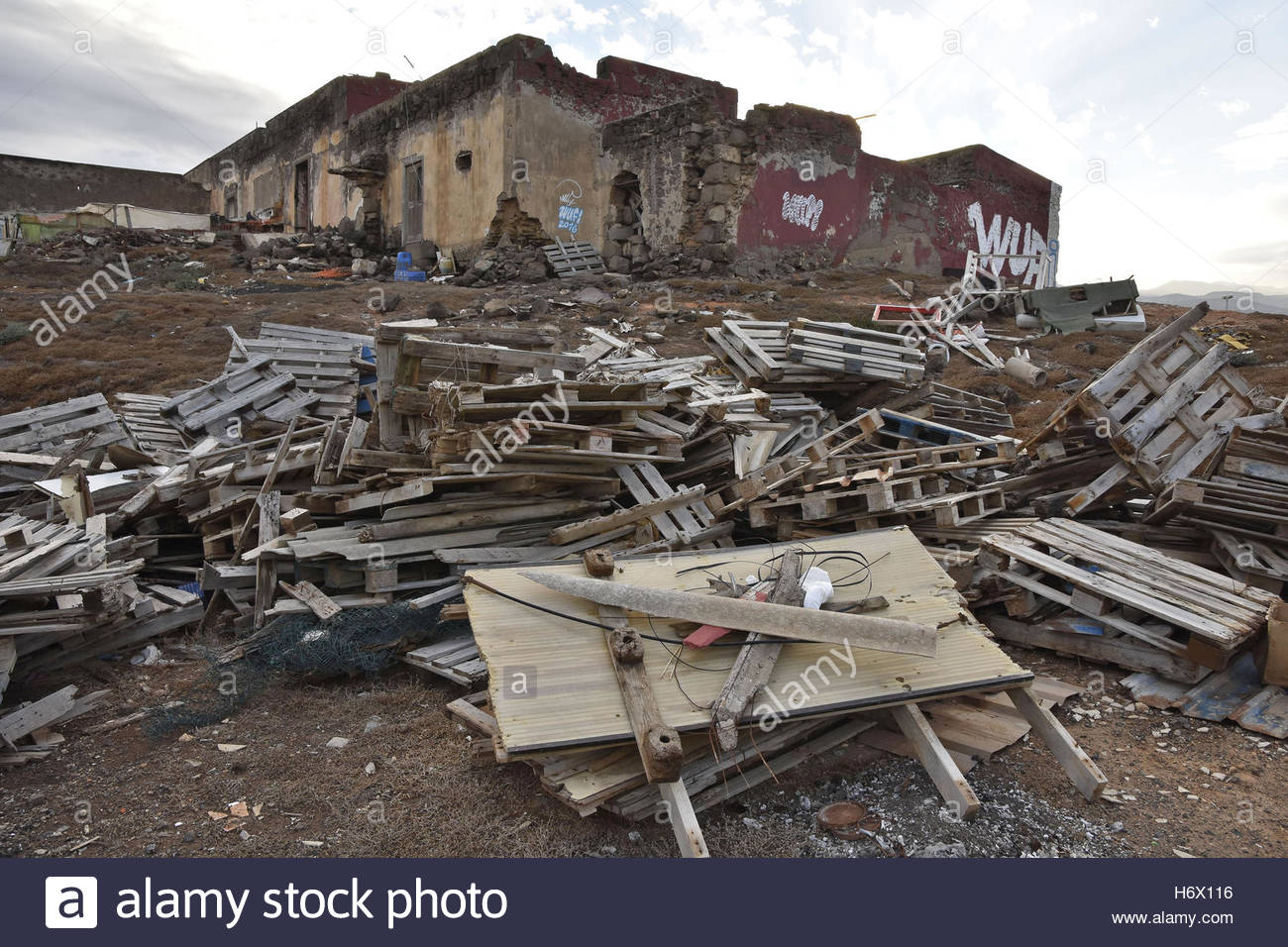 Rubbish junk dumped next to abandoned derelict house in Gran Canaria Canary Islands Spain - Stock Image