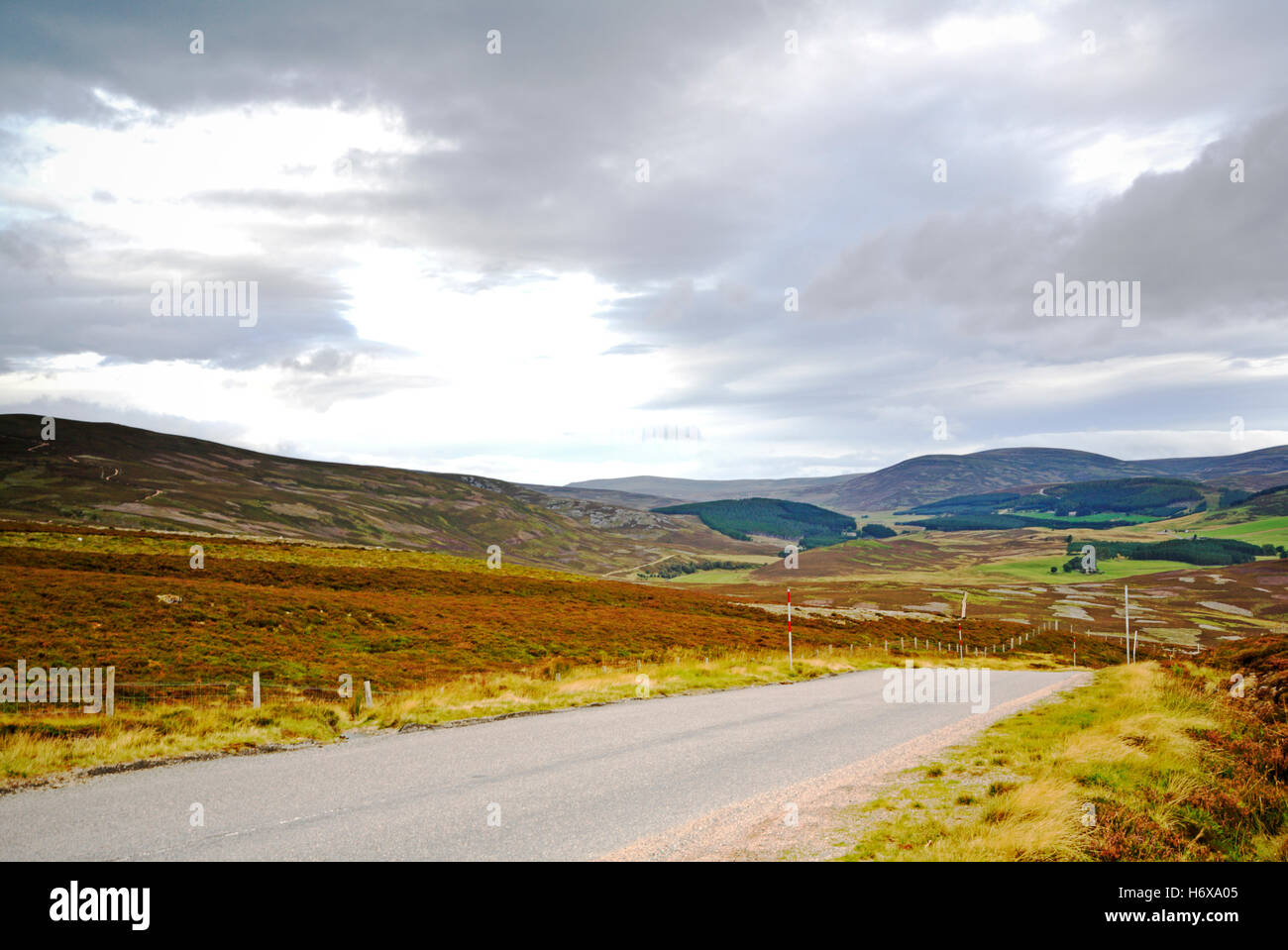 A view of the A939 Old Military Road running over moorland and the Grampian Mountains, Aberdeenshie, Scotland, United - Stock Image