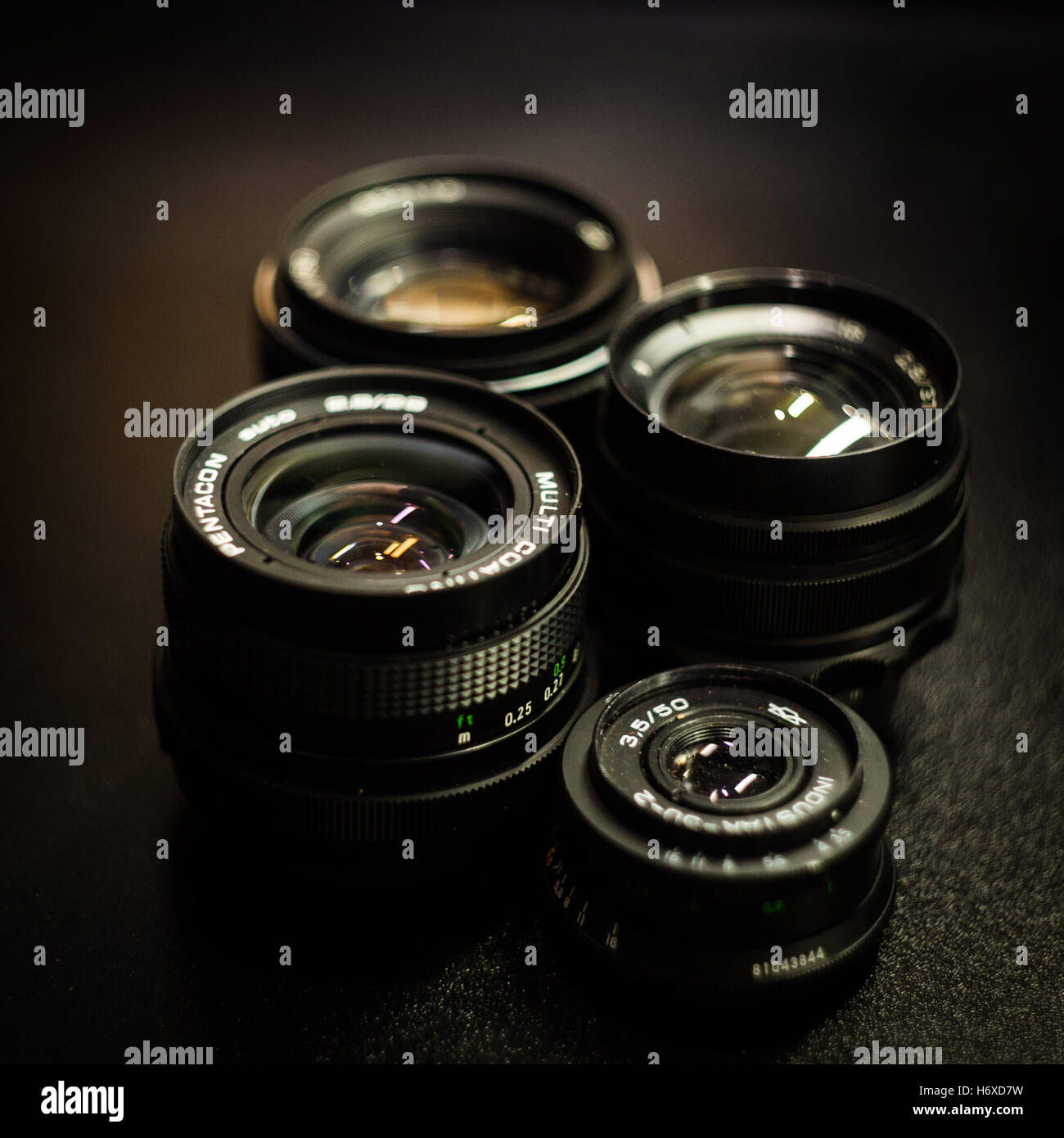 Retro photo camera lens on dark background - Stock Image