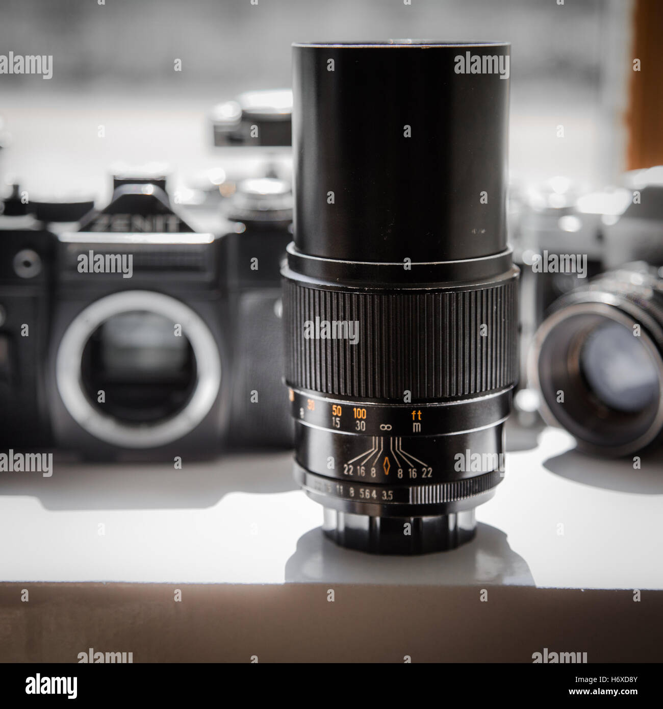 Retro camera lens and cameras - Stock Image