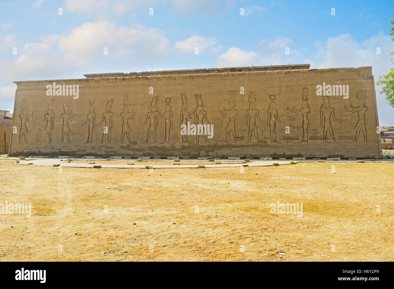 The massive trapezoidal wall of the Horus Temple decorated with the scenes of life of ancient Egyptian gods, Edfu, - Stock Image