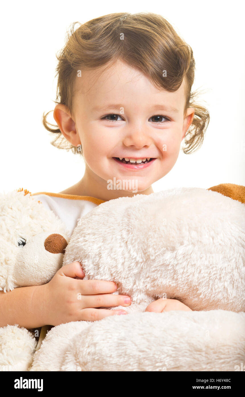 Three years little girl with her toy dogs. - Stock Image