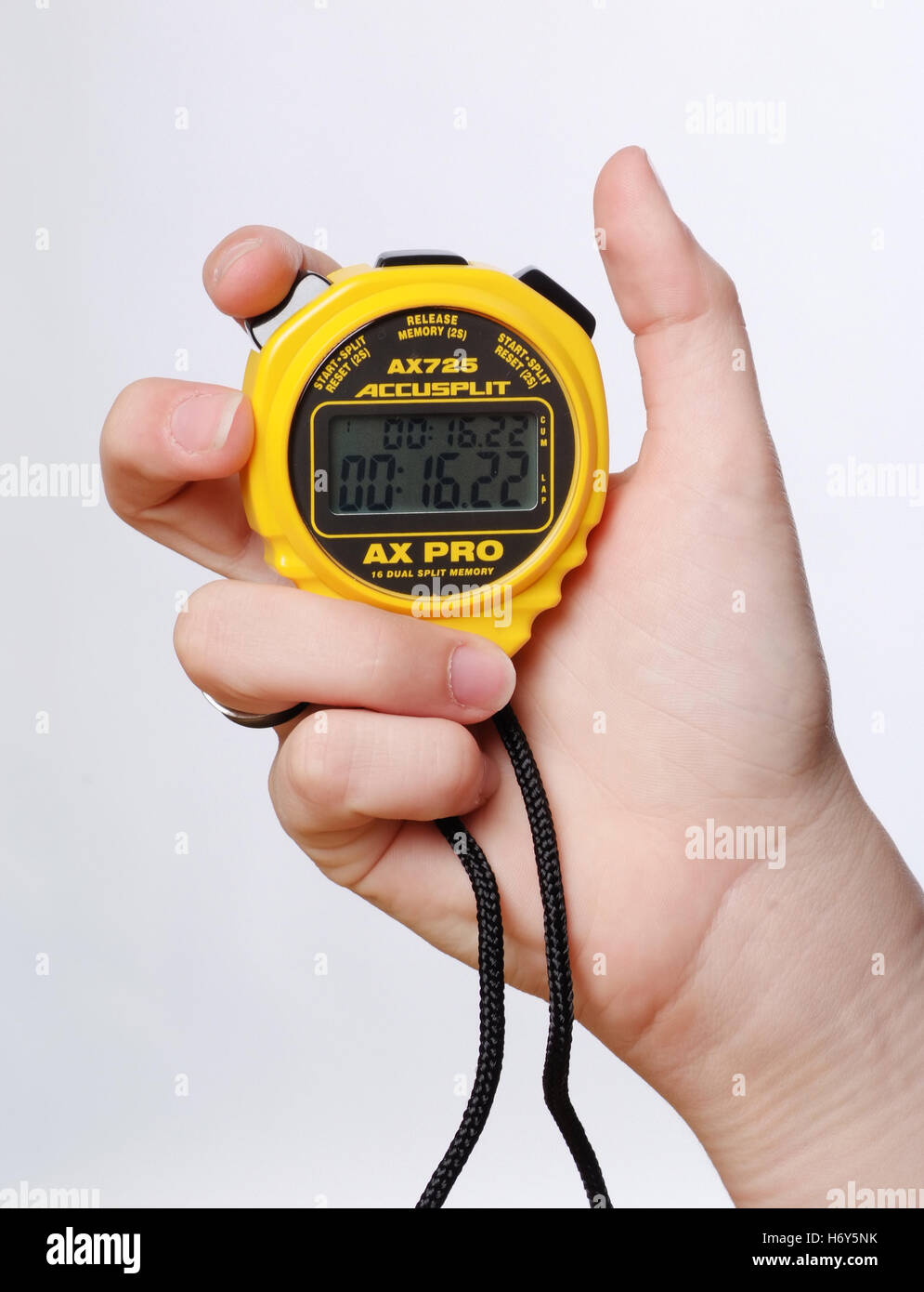 Hand holding a digital stopwatch. - Stock Image