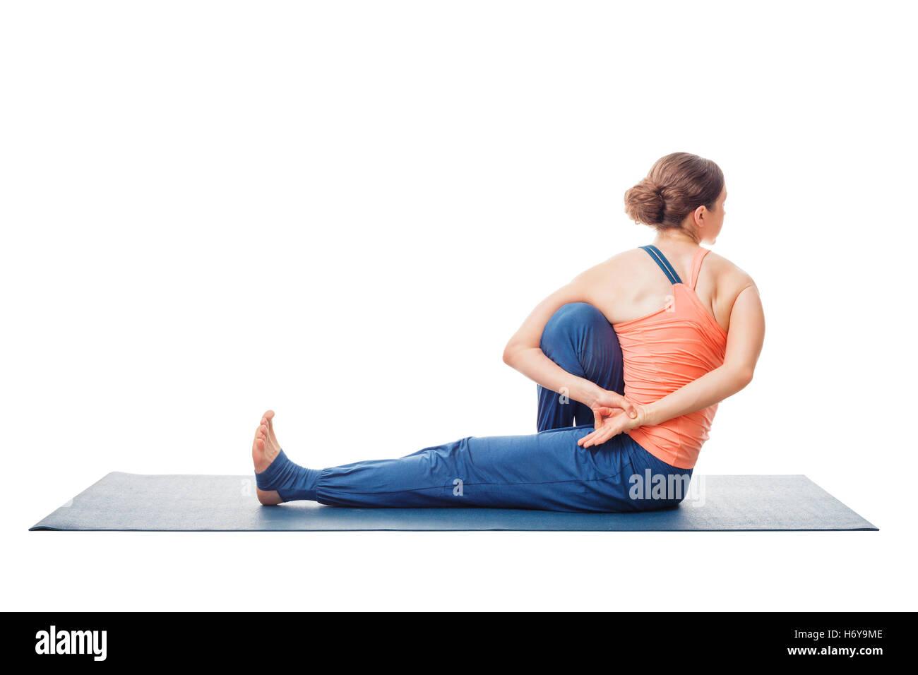 Woman Doing Ashtanga Vinyasa Yoga Asana Marichyasana C