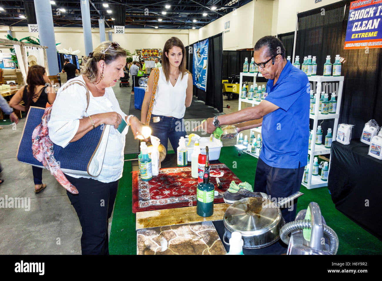 Florida Miami Beach Convention Center Centre Home Design And Remodeling Show  Black Man Salesman Selling Product Demonstration Demonstrating Shock It C