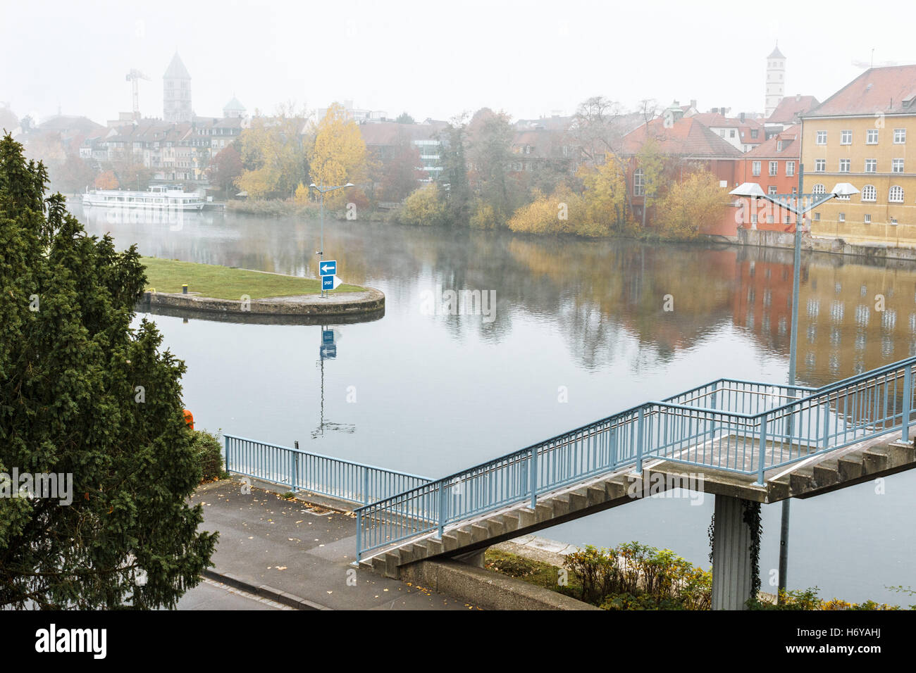 European old city with river in autumn - Stock Image
