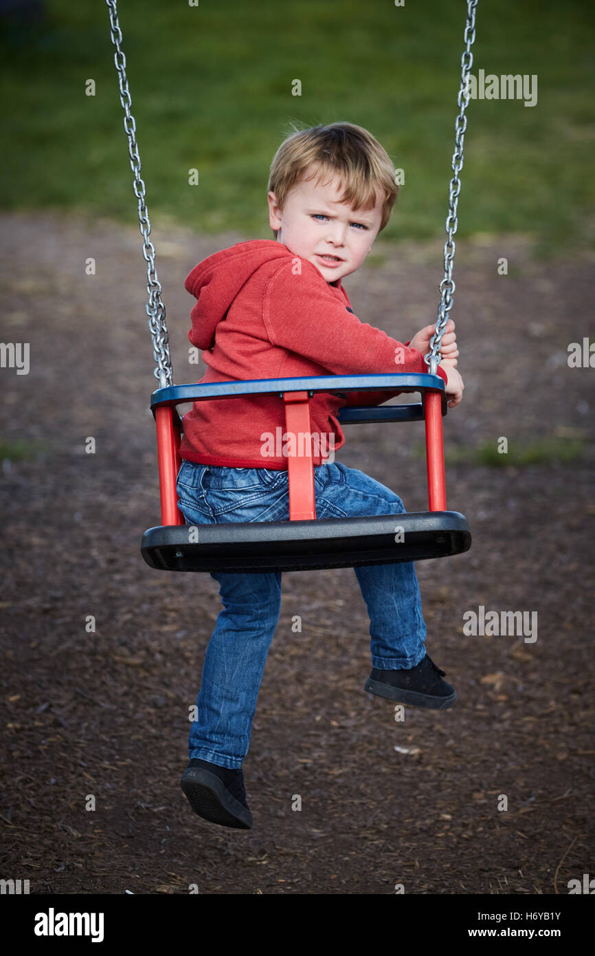 kenyon hall farm playground swings   Park open space public recreation recreational play playing fields land parks - Stock Image