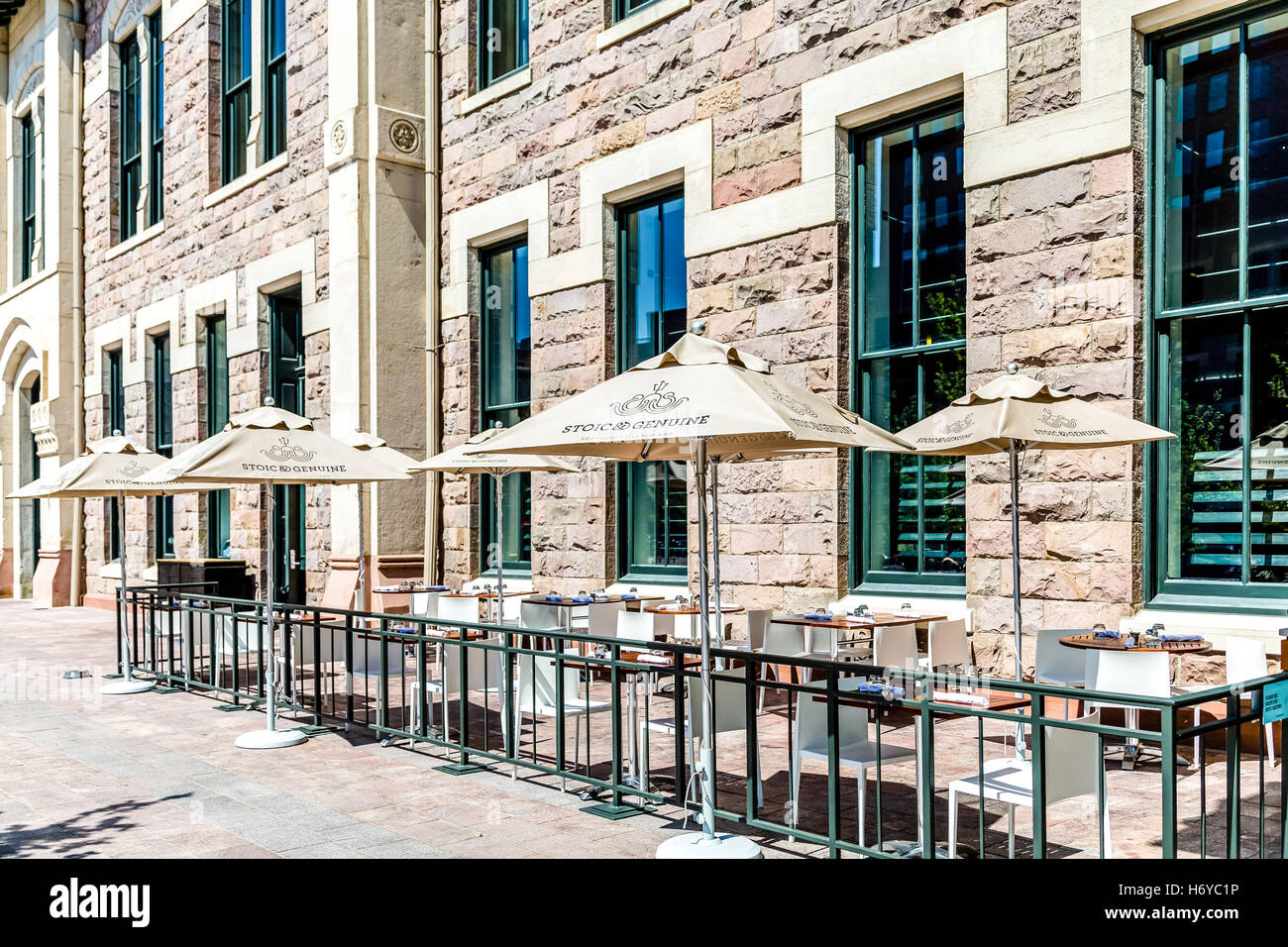 Umbrellas and Outdoor Seating at Stoic & Genuine - Stock Image