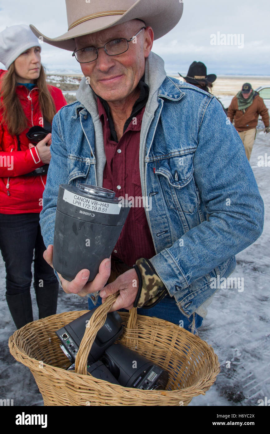 LaVoy Finicum shows off purported  FBI surveillance cameras discovered and confiscated by the occupiers. - Stock Image